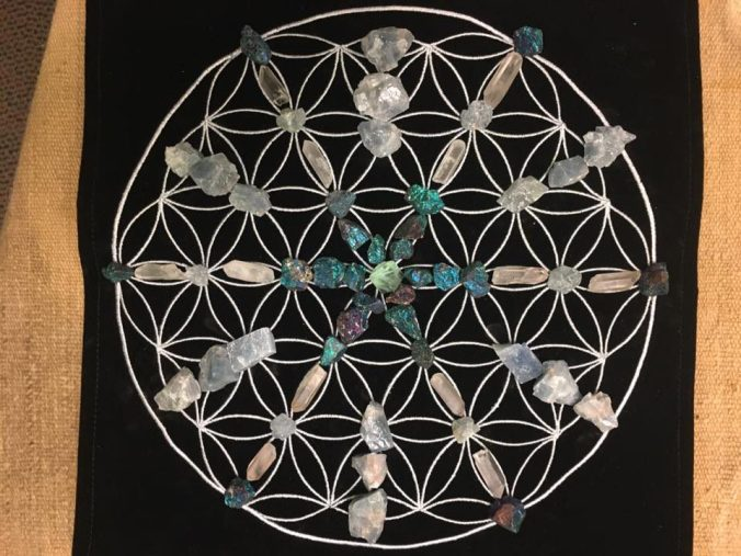 Crystal Grid on a Flower of Life mat - celestite, blue calcite, peacock ore and quartz